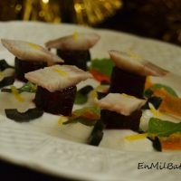 Anguila ahumada con salsa de yogur